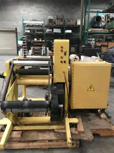 Comco Horizontal Press Rewinder