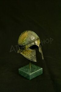 Ancient Greek Bronze Helmet On Marble Base
