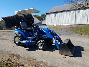 2006 New Holland Tz25da Compact Tractor W Loader Belly Mount Lawn Mower Hydro