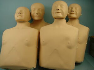 Lot Of 4 Laerdal Little Anne Adult Cpr Manikins W Lots Of Extras Cases Masks
