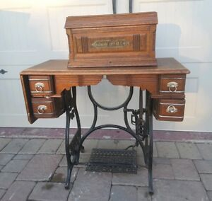 Antique Year 1889 New Home Treadle Sewing Machine Wood Cabinet