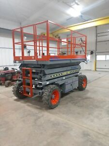 2007 Sky Jack Scissor Lift model 7127 4wheel Dr 2400 Hr Gas Reconditioned