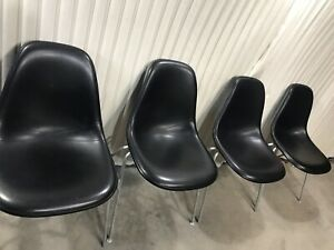 Set Of Four Black Vinyl Black Fiberglass Herman Miller Eames Shell Chairs