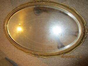 Vintage Oval Wall Mirror With Ornate Gilt Frame And Bevelled Mirror