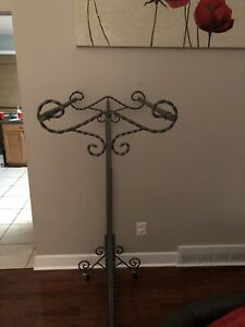 Beautiful Metal Antique Scrolled Women s Clothing Rack With Locking Wheels