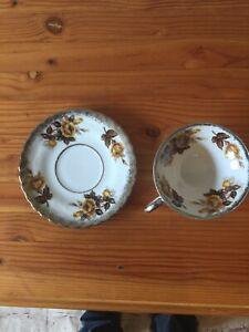 Beautiful Vintage Tea Cup With Yellow Roses And Silver Trim And Saucer