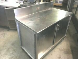 Table Cabinet Stand 48 X 28 X 35 h Stainless steel With Slide Door On Wheels