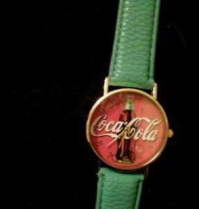 Coca Cola Watch with Green strap  brand new. Great for collecters too!
