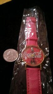 Coca Cola Watch  pink rose color wrist band.Brand new. Perfect for collecters.