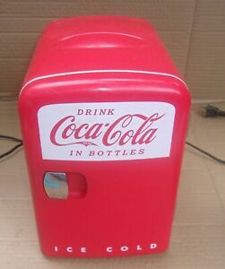 COCA COLA MINI FRIDGE BY KOOLATRON WORKS FINE COMES WITH AC CORDS NEEDS CLEANING