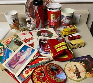 LOT of Coca Cola advertising  magazines  coasters  cups  and trucks