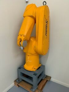 Staubli Rx130l Robot Arm Cs7 Controller Cable Working On Wooden Pallet