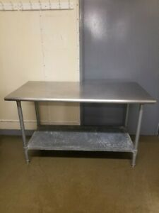 Stainless Steel Table With Galvanized Legs And Lower Shelf
