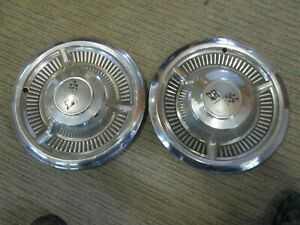 Two 1958 Chevy Impala Bel Air Crossed Flags Chevrolet 14 Hubcaps