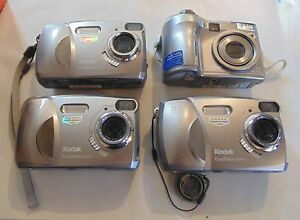Lot Of 4 Cameras For Parts Or Rebuild Kodak Cx4310 Olympus Sp 310