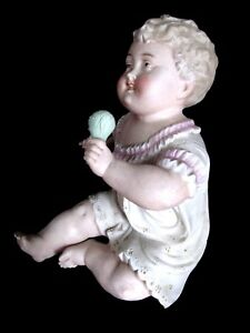 Antique German Bisque Porcelain Piano Baby With Rattle