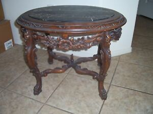 Antique French Style Oval Carved Table With Marble Insert Grotesque Faces