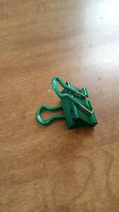 Used Binder Clip Green Mediumish Metallic One Million Dollars