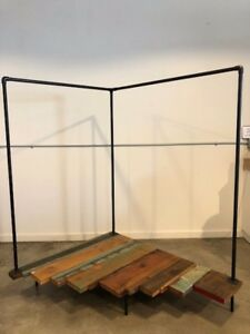 Clothing garment Rack For Retail Display Made From Black Pipe And Reclaimed Wood