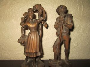 Hand Carved Old Man And Woman Gathering Wood
