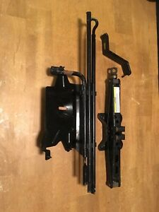 1999 04 Jeep Grand Cherokee Spare Tire Jack And Tool Kit Hold Down Brackets Oem