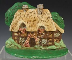 Vintage Cast Iron Cozy Cottage Doorstop