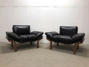 Updated Pair Of Danish Modern Komfort Leather And Teak Floating Lounge Chairs