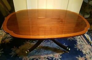 Signed Stickley Cherry Banded Top And Carved Base Coffee Table