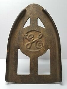 Antique Ge General Electric Cast Sad Iron Footed Trivet Rest Stand