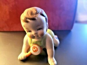 Vintage Baby Crawling With Rattle Bisque Porcelain Figurine