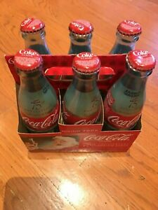 new Coca Cola 6 Pack Holiday 75 anniversary Bottle  2006 Sunblom Santa Sealed