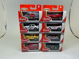 MATCHBOX- COCA-COLA-LOT OF 8-VEHICLES--2002-SEALED IN BOXES----