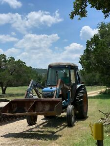 6710 Ford Tractor With Front End Loader With Bucket And Post Hole Digger