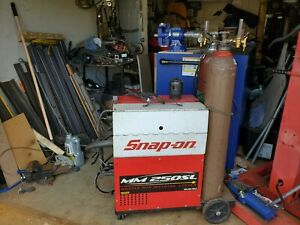 Snap On Tool Box With Tools And Welder Machine