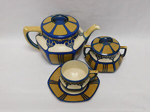 Mettlach Tea Set Of Large Teapot Covered Sugar And Cup Saucer
