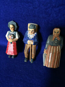 Three Carved Painted Swiss Wooden Figures