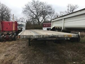 2002 Utility 48 Spread Axle With Pipe Stakes