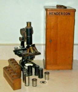 Vintage Cast Iron Brass Bausch Lomb Microscope W 8 Lenses And Wooden Box