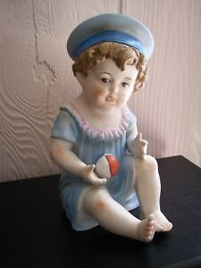 Vintage Piano Baby Girl Holding Ball 9 Porcelain Doll Figurine