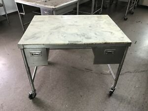Stainless Steel Table With Marble Top And Casters 48 Wide