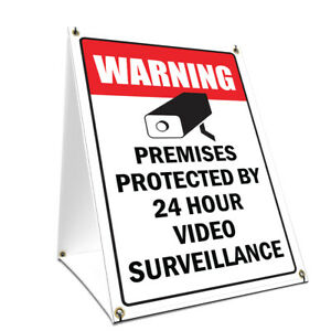 A frame Sidewalk Video Surveillance Sign With Graphics On Each Side 24 X 36