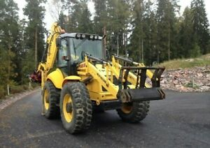 2006 New Holland Lb115b 4ps Backhoe Loader With Buckets And Accessories