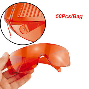 50pcs bag Red Lens Goggle Glasses Uv Protective Eye Curing For Safety Lab Dental