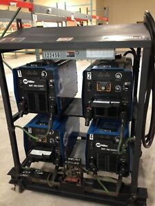 Miller Xmt 450 Cc cv Welders 4 Pack With Rack On Wheels And Power Cable