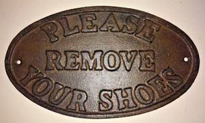 Please Remove Your Shoes Sign Oval Plaque Cast Iron Metal Brown Patina Finish