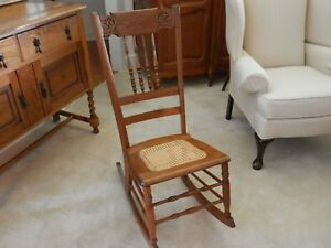 Antique Oak Pressed Back Rocking Chair With Cane Seat