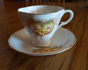 Clarence Company English Bone China Tea Cup And Saucer 1952 Yellow Flower
