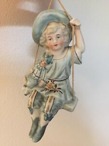 Antique C1890 German Bisque Porcelain Figurine Girl On Swing Holding Punch Doll