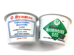 Two Tubs Of Dynatex And Lube Gard Transmission Assembly Lube 1 Blue And 1 Green