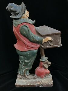 Circa 1920s Antique Cast Iron Organ Grinder With Monkey Doorstop